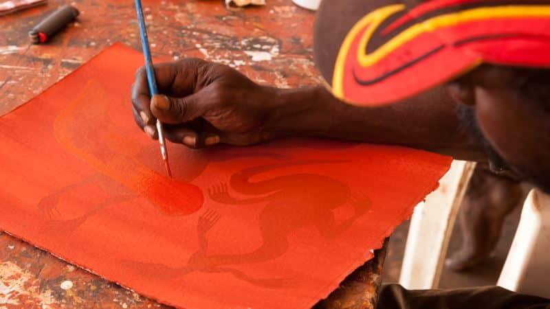 man_painting_at_art_centre
